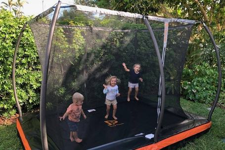 In-ground-rectangular-trampoline-kids-gettrampoline.com