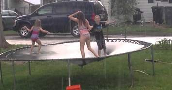 Jumping-on-trampoline-in-the-rain