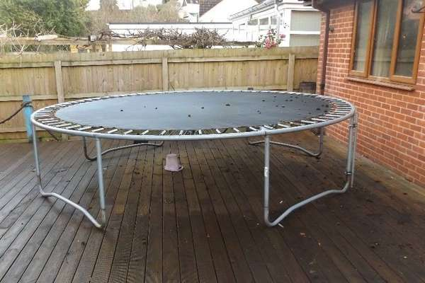trampoline-on-wooden-deck-backyard-12-ft-opt